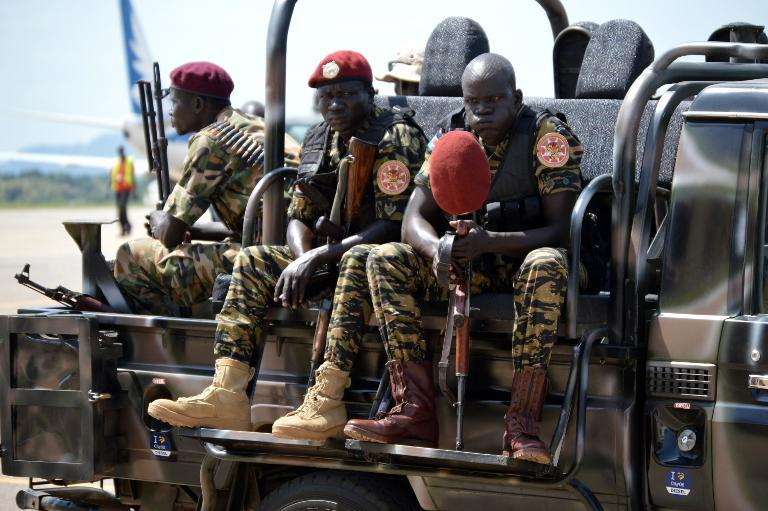 South Sudan's soldiers sit on a truck at the airport in Juba on June 12, 2014  (AFP Photo/Samir Bol)