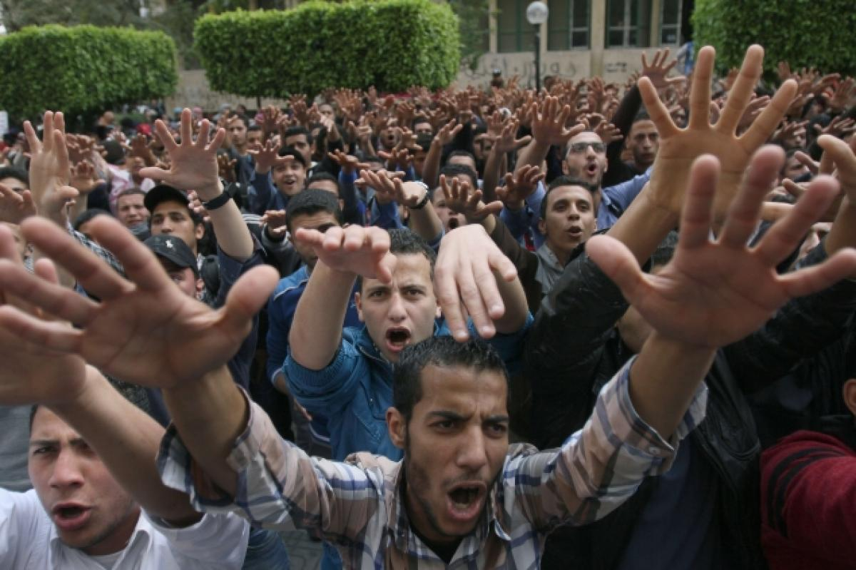 Students from Cairo University, supporters of ousted Islamist president Mohamed Morsi, demonstrate on Wednesday as violence erupted in Egypt (MOHAMED EL-SHAHED/AFP/GETTY IMAGES)