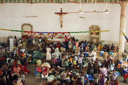 South Sudanese take refuge in the Malakal Catholic Church on January 21, 2014, fleeing fighting between rebels and government forces  (AFP, Charles Lomodong)