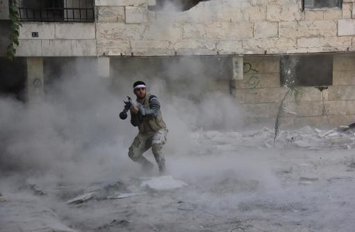 An opposition fighter fires a rocket propelled grenade during clashes in the Salaheddin district of the northern Syrian city of Aleppo on October 9, 2013 (Abo Al-Nur Sadk/AFP/File, Abo al-Nur Sadk)