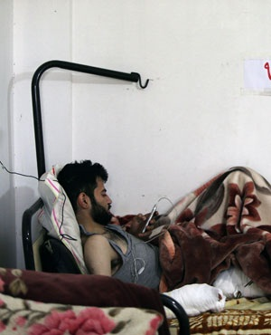 An injured Syrian man, who fled Yabrud, rests at a field hospital in the city of Arsal in Lebanon's Bekaa valley.  (Joseph Eid, AFP)
