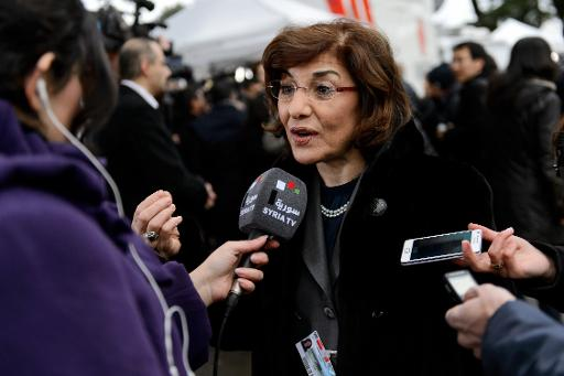 Syrian senior presidential advisor Buthaina Shaaban speaks to a Syrian TV reporter at the United Nations Offices in Geneva, on January 26, 2014  (AFP, Fabrice Coffrini)