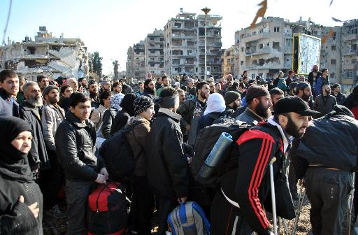 Syrian civilians wait to be evacuated by UN staff from the besieged district of the central city of Homs, on February 9, 2014  (AFP/File, Bassel Tawil)