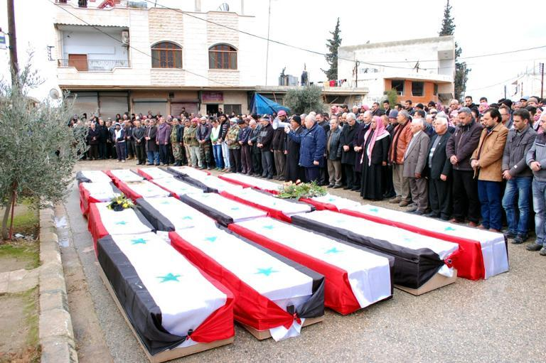 Syrians pay their respects to the victims of a car bomb attack in the village of Kafat in the central Hama province on January 10, 2014  (AFP File Photo)