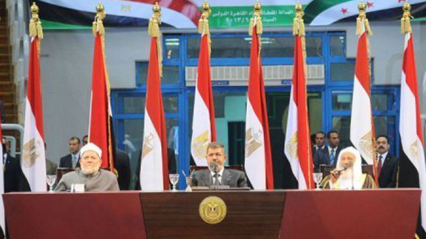 In this picture released on June 15, 2013, President Mohammed Morsi waits to address Islamist supporters in Cairo (AFP Photo)