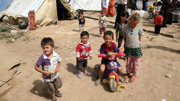 Syrian-Kurdish children refugee play outside tents at the Domiz refugee camp, 20 km southeast of the northern Iraqi city of Dohuk, on June 19, 2013. (AFP Photo / Safin Hamed)