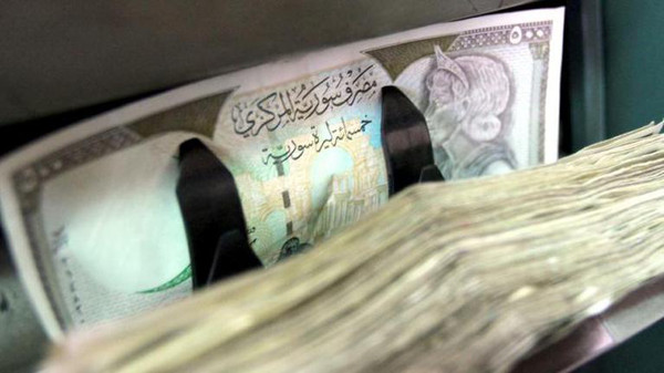 The severely weakened Syrian pound has surged against the dollar in recent days, a trader said Tuesday, with experts pointing to central bank intervention and developments favourable to the regime. (AFP Photo)