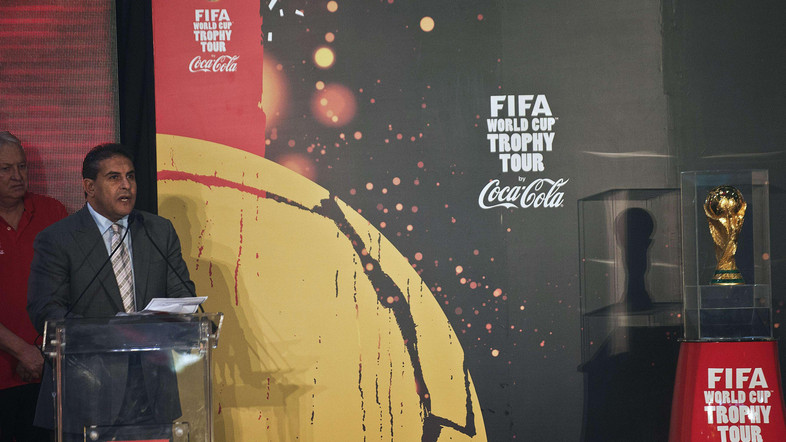 Egyptian Sports Minister, Taher Abu Zeid gives a speech during the presentation of the FIFA World Cup trophy (R) as part of the FIFA World Cup Trophy Tour on November 14, 2013 at Cairo International Airport, Egypt. (AFP PHOTO/GIANLUIGI GUERCIA)