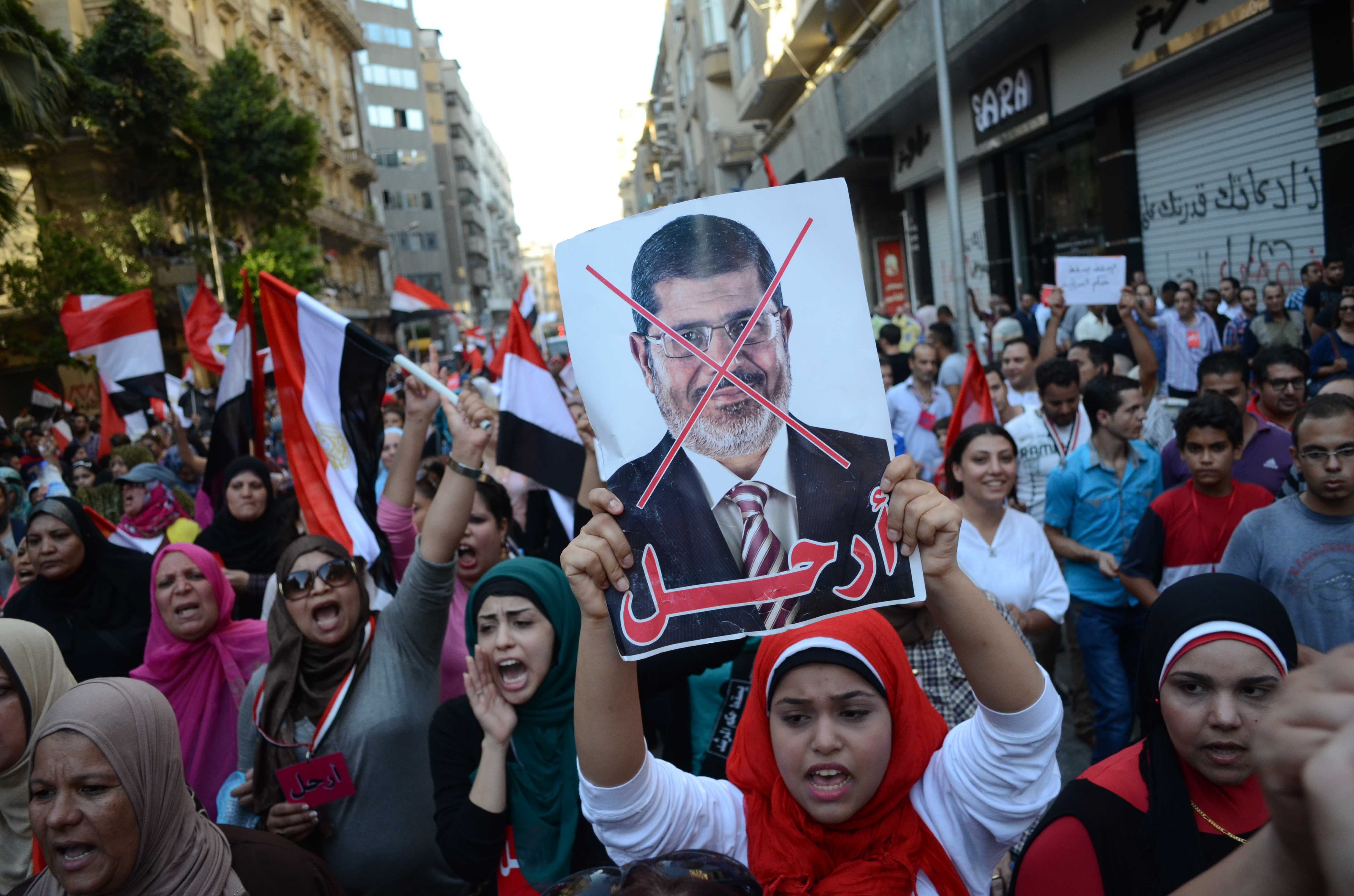 Morsi claimed that all citizens who stood military trials were released, and that all those who were sentenced received full amnesty. (Photo by Halim Al-Shaarani\ File photo)