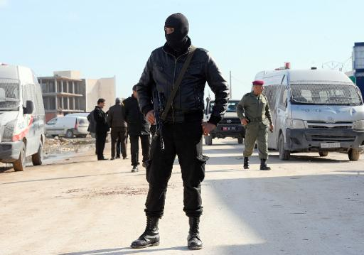 A member of a special unit of the Tunisian National Guard stands near a building in the Tunis suburb of Raoued on February 4, 2014  (AFP/File, Fethi Belaid)