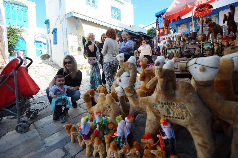 File picture shows tourists looking at souvenirs in the suburb of Sidi Bou Said near Tunis  (AFP Photo/Fethi Belaid)