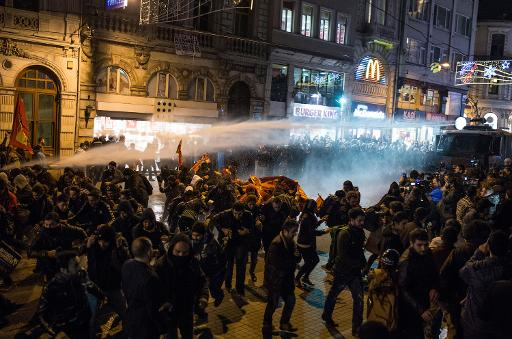 Police use water cannon to try to disperse people protesting against newly proposed restrictions on the use of the internet and against the Turkish government during a protest in Istanbul on January 18, 2014  (AFP, Mete Carkci)