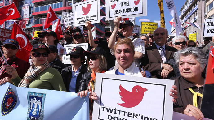 """Protesters hold placards reading """"do not touch my twitter """" and """"communication right is a basic human right"""" during a demonstration against the ban on Twitter during a demonstration against Turkish government in Ankara on March 22, 2014.  (AFP Photo / Adem Altan)"""