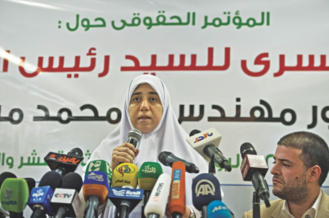 Shaimaa Mohamed Morsi, the daughter of Egypt's ousted president Mohamed Morsi speaks during a press conference as his son Osama listens on, in Cairo on July 22, 2013.  (AFP PHOTO / KHALED DESOUKI)