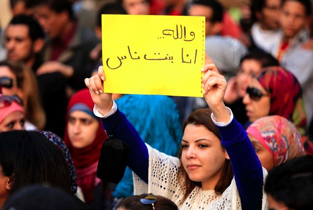 An Egyptian woman holds a sign reading 'I come from a respectable family' during a protest in downtown Cairo to denounce the military's attacks on women and to call for an immediate end to the violence against protesters on December 2011.