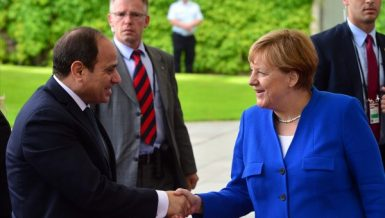 Egypt's President Abdel Fattah Al-Sisi with German Chancellor Angela Merkel