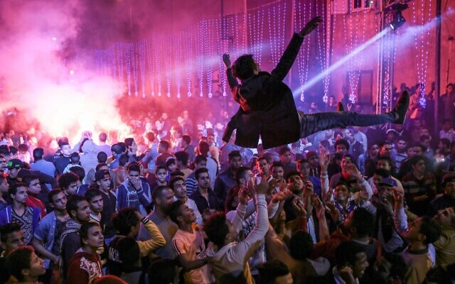Youth youth dance to Mahraganat music at a local wedding in Egypt