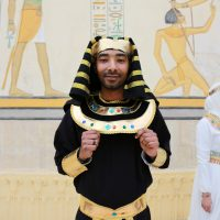 the grrom wearing ancient egyptian clothes