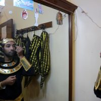 the groom wearing ancient Egyptian clothes