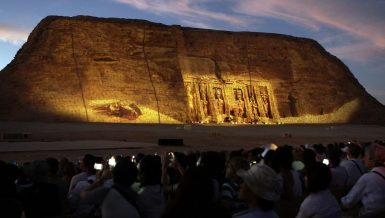 Sun illuminates face of Ramses II in Abu Simbel Temple Aswan Egypt