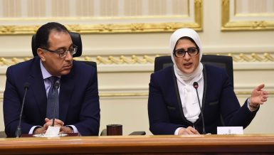 Egypt's Health Minister Hala Zayed (right) and Prime Minister Mostafa Madbouly during a coronavirus press conference