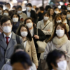 People walking wearing maks amid coronavirus COVID-19 pandemi Along with Tokyo, some other urban areas have also seen sharp increases of infections since a nationwide state of emergency was completely lifted in late May.c in Japan