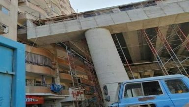Viral photos, which have sparked controversy online, showed the under-construction El Zomor Canal Axis directly adjacent to residential buildings in Giza's Al-Haram neighbourhood.