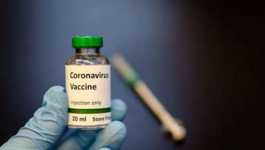 Hand carrying a Coronavirus (COVID-19) vaccine Daily News Egypt