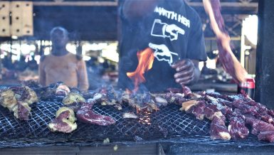 Man grilling Namibian cuisine kapana (grilled meat) Daily News Egypt
