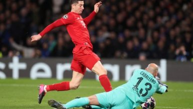 Bayern Munich's Robert Lewandowski (L) is blocked, Feb. 25, 2020. (Photo by Matthew Impey-Xinhua)