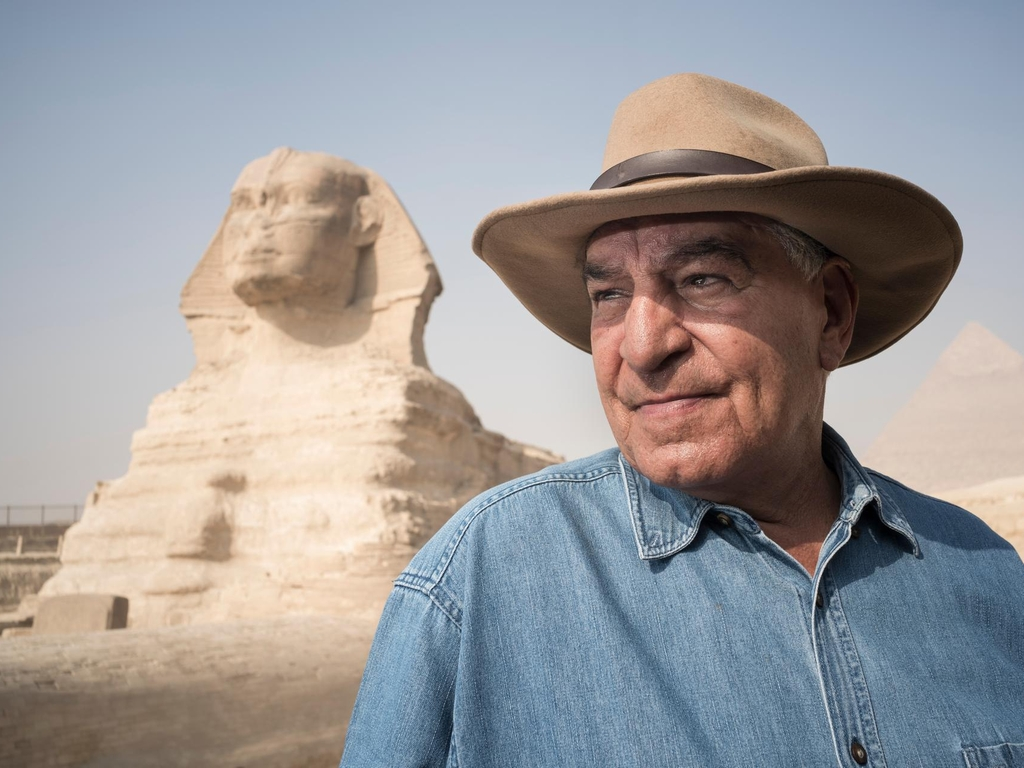 Zahi Hawass with the Sphinx in Giza Plateau on the outskirts of Cairo, Egypt, site of the Fourth Dynasty Giza Necropolis, which includes the Great Pyramids of Khufu, Khafre and Menkaure,