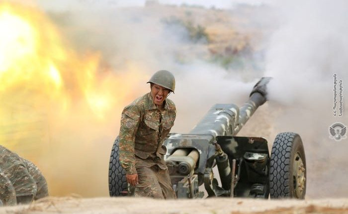 An ethnic Armenian soldier fires an artillery piece during fighting with Azerbaijan's forces in the breakaway region of Nagorno-Karabakh, September 29, 2020. Armenia Defense Ministry/Handout via REUTERS