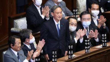 Yoshihide Suga (C) stands after being elected as Japan's new prime minister in Tokyo, Japan, on Sept. 16, 2020.