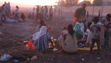 Ethiopian refugees fleeing clashes in the country's northern Tigray region, rest and cook meals near UNHCR's Hamdayet reception centre after crossing into Sudan. Photo credit: © UNHCR- Hazim Elhag