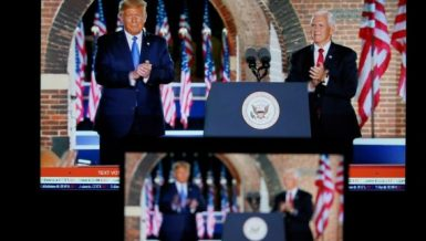 Photo taken in Arlington, Virginia, the United States, on Aug. 26, 2020 shows screens displaying U.S. Vice President Mike Pence (R) being joined onstage by U.S. President Donald Trump after delivering his speech during the 2020 Republican National Convention from Fort McHenry in Baltimore, Maryland. (Xinhua/Liu Jie)