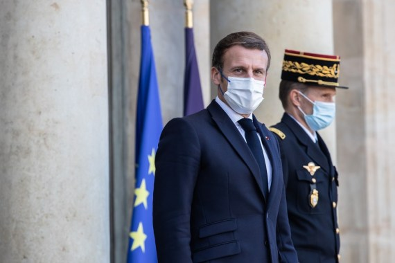 French President Emmanuel Macron (L) appearing ahead of the third Paris Peace Forum at the Elysee Palace in Paris, France. (Photo by Aurelien Morissard-Xinhua)
