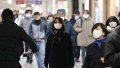 People wearing face masks walk in Tokyo, Japan, Jan. 7, 2021. (Xinhua-Du Xiaoyi)