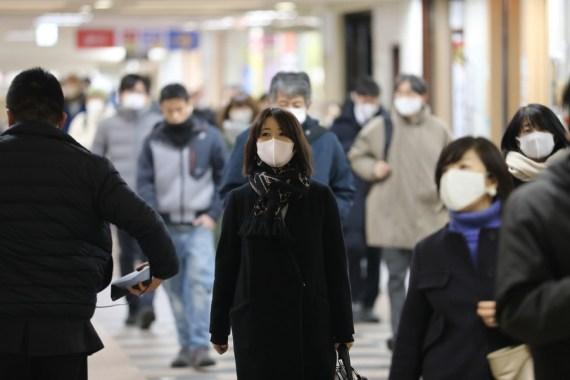 People wearing face masks walk in Tokyo, Japan, Jan. 7, 2021. (Xinhua-Du Xiaoyi)