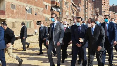 Egyptian president and Egypt's prime Minister inspection tour of the Ezbet El Haggana slum area in Cairo