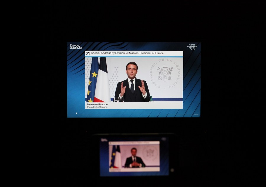 Photo taken in Paris, France, on Jan. 26, 2021 shows screens displaying French President Emmanuel Macron attending the virtual World Economic Forum (WEF) Davos Agenda meeting. (Xinhua/Gao Jing)